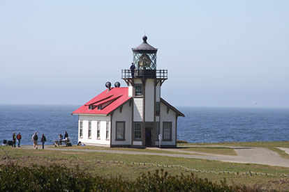 photo of the point cabrillo lighthouse next to the ocean.