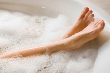 a photo of someone relaxing in a bubble bath.