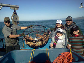 Photo of family fishing off a charter boat.