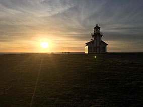 photo showing one of the light houses near Fort Bragg in a beautiful sunset background.